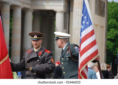 BERLIN, GERMANY-MAY 19: Unidentified young men dress as American soldiers stand in front the check point Charlie remembering the cold war on May 19, 2010 in Berlin Germany
