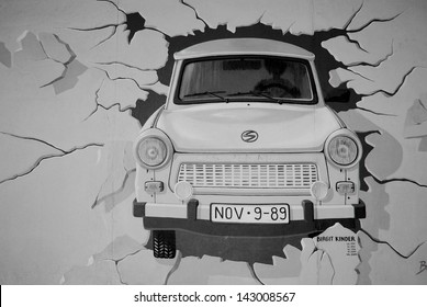 BERLIN GERMANY-MAY 22: Trabant by Birgit Kinder on the Berlin Wall on may 22 2010 in Berlin Germany. East Side Gallery - the largest outdoor art gallery in the world.