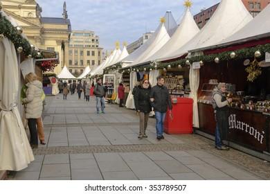 BERLIN, GERMANY--NOVEMBER 24, 2015--Early morning visitors to the Christmas market in Gendarmenmarkt, Berlin, Germany