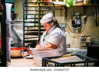 BERLIN, GERMANY-OCT 26, 2016: Portrait of german female chef with cooked food standing in the kitchen in Berlin, on Oct 26, 2016, Germany.
