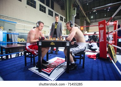 BERLIN - JANUARY 19:  Chess boxing at the Bread & Butter fair on January 19, 2011 in Berlin, Germany. Tens of thousands of visitors attended the trade show this year.
