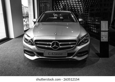 BERLIN - JANUARY 24, 2015: Showroom. Compact executive car Mercedes-Benz C220 BT Limousine. Black and white. Produced since 2014.