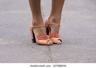 BERLIN - July 10, 2015: Stylish woman wearing orange shoes with rivets. Berlin Fashion Week Spring / Summer 2016