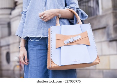 BERLIN - July 10, 2015: Stylish woman carrying a pastel blue and pink bag in front of the Kronzprinzenpalais. Berlin Fashion Week Spring / Summer 2016