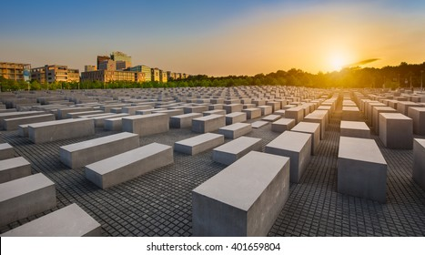 BERLIN - JULY 17 2015: Panoramic view of famous Jewish Holocaust Memorial near Brandenburg Gate in golden evening light with blue sky at sunset in summer on July 17, 2015 in Berlin Mitte, Germany