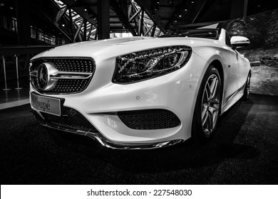 BERLIN - JULY 18, 2014: Showroom. Mercedes-Benz S 500 Coupe (C217). The newest luxury car (since 2014). Black and white.