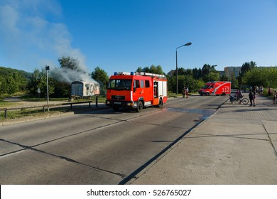 BERLIN - JULY 21, 2013: The fire of construction trailer. District of Marzahn-Hellersdorf. The arrival of fire truck. Fire brigade at work.