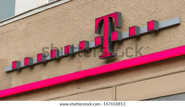 BERLIN - JULY 24: Emblem T-Mobile. T-Mobile International AG is a holding company for Deutsche Telekom AG's various mobile communications subsidiaries outside Germany, July 24, 2013, Berlin, Germany