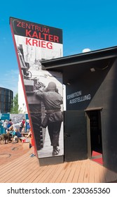 BERLIN - JULY 29, 2014: The BlackBox Cold War exhibition center opened in September 2012. It is an open-air exhibition with 175 large photos about the history of Checkpoint Charlie and its importance.