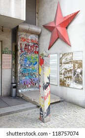 BERLIN - JULY 31: Berlin wall and red star on July 31, 2012 in Berlin. The German Democratic Republic column and Berlin wall portion near Checkpoint Charlie were part of East sector during Cold War.