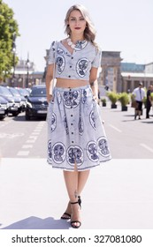 BERLIN - July 7, 2015: Stylish woman wearing T-shirt and skirt with blue prints. Berlin Fashion Week Spring / Summer 2016