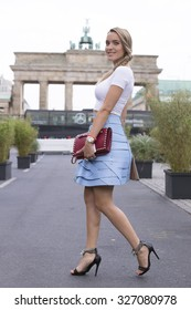BERLIN - July 8, 2015: Stylish woman wearing black shoes, pastel blue skirt and a white sleeveless T-shirt. Berlin Fashion Week Spring / Summer 2016
