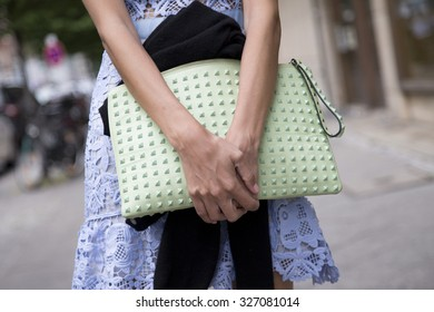BERLIN - July 8, 2015: Stylish woman carrying a pastel green bag with rivets. Berlin Fashion Week Spring / Summer 2016