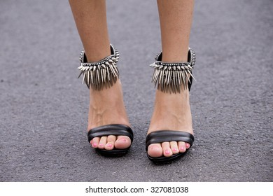 BERLIN - July 8, 2015: Stylish woman wearing black shoes with rivets. Berlin Fashion Week Spring / Summer 2016