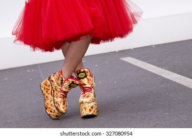 BERLIN - July 8, 2015: Young stylish woman wearing a red dress and wedge shoes. Berlin Fashion Week Spring / Summer 2016