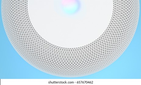 BERLIN - June 01, 2017: Apple HomePod Assistant White, Siri Voice Service activated recognition system photographed on blue studio backdrop