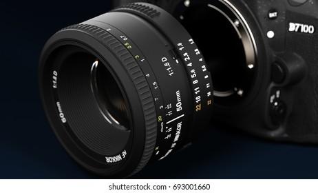 BERLIN - June 02, 2017: Nikon D7100 Digital Lens Reflex Camera, Blue Background, Detached Lens, Mood Packshot