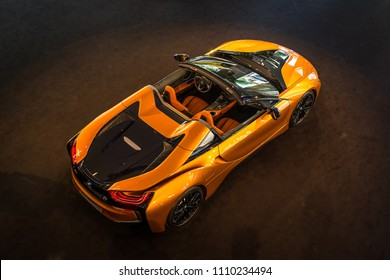 BERLIN - JUNE 09, 2018: Showroom. A plug-in hybrid sports car BMW i8 Roadster. View from above.