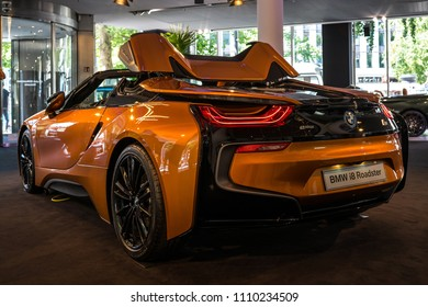 BERLIN - JUNE 09, 2018: Showroom. A plug-in hybrid sports car BMW i8 Roadster. Rear view.