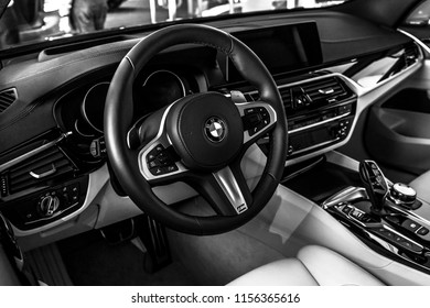 BERLIN - JUNE 09, 2018: Showroom. Interior of a mid-size luxury car BMW 6 Series (G32). Black and white.