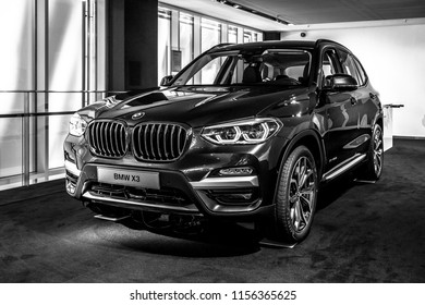 BERLIN - JUNE 09, 2018: Showroom. Compact luxury crossover SUV BMW X3. Black and white.