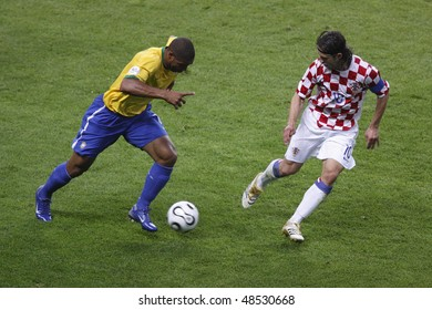 BERLIN - JUNE 13:  Adriano of Brazil (l) moves the ball against Niko Kovac of Croatia during a World Cup match June 13, 2006 in Berlin, Germany. Editorial use only.  No pushing to mobile device usage.