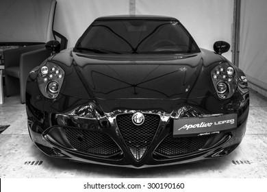 BERLIN - JUNE 14, 2015: Sports car Alfa Romeo 4C (since 2014). Black and white. The Classic Days on Kurfuerstendamm.