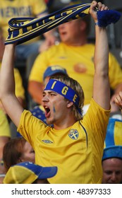 BERLIN - JUNE 15:  A Swedish supporter cheers prior to the start of a 2006 FIFA World Cup soccer match between Sweden and Paraguay June 15, 2006 in Berlin, Germany.