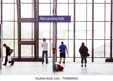 BERLIN - JUNE 16: A family wiaiting for the train on the platform of Alexanderplatz station on June 16, 2012 in Berlin, Germany.