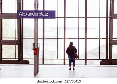 BERLIN - JUNE 16: A woman waiting for the train on the platform of Alexanderplatz station on June 16, 2012 in Berlin, Germany.