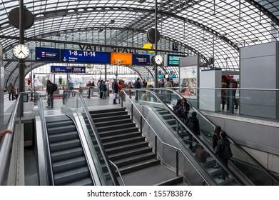 BERLIN - JUNE 2: People inside the Berlin Central train station on 2 June 2013 in Berlin, Germany. It is the is the main railway station in Berlin with a surface area of 85x120 mt.