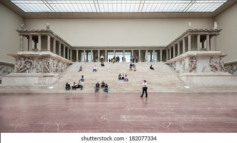 BERLIN - JUNE 3, 2013: Tourists inside the Hall of Pergamon museum, the most visited in Berlin. It hosts more than 1.5 million visitors per year.