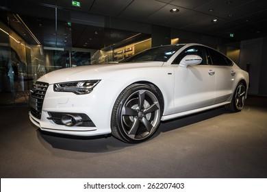 BERLIN - MARCH 08, 2015: Showroom. Executive car/mid-size luxury car Audi A7 3.0 TDI quattro (2014). Audi AG  is a German automobile manufacturer.
