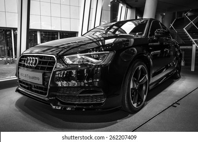 BERLIN - MARCH 08, 2015: Showroom. Compact executive car Audi A3 1.8 T quattro. Black and white. Audi A3 is a winner World Car of the Year 2014