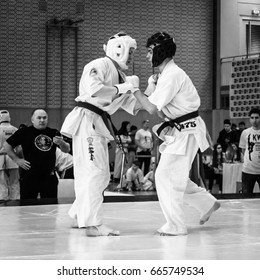 BERLIN - MARCH 18, 2017: Fighters on the tatami. Black and white. European championship Kyokushin World Union (KWU) for Children and Youth.