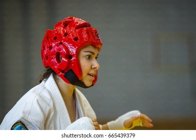 BERLIN - MARCH 18, 2017: Girl-fighter in a protective helmet, close-up. European championship Kyokushin World Union (KWU) for Children and Youth.