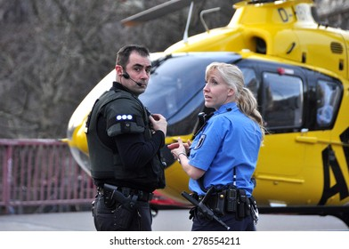 BERLIN - March 3: Two police workers control the situation during knifing accident on March 3, 2015 in Berlin, Germany.