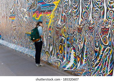 BERLIN - MARCH 30, 2014: East Side Gallery in Berlin contains artwork and graffiti and is an international memorial for freedom. The wall is 1.3km long.