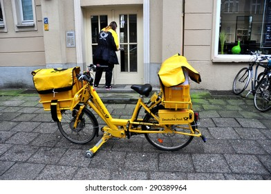 BERLIN MARCH 6: Postman on a bicycle (over 15% people in Berlin prefer moving by bike) on March 6, 2015.