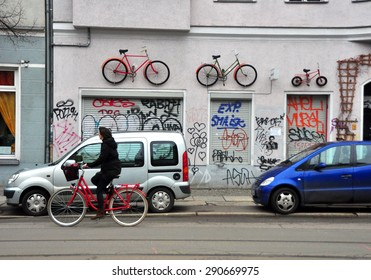 BERLIN MARCH 6: Unidentified female riding the bicycle (over 15% people in Berlin prefer moving by bike) on March 6, 2015.