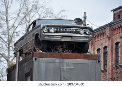 BERLIN MARCH 6:  Vintage car on the pedestal in Eastern Berlin on March 6, 2015.