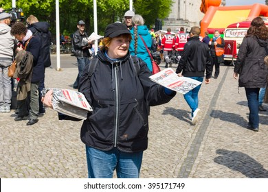 BERLIN - MAY 01, 2015:  International Labour Day. Distributor of free newspapers.