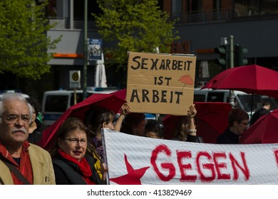 "BERLIN - MAY 01, 2016: The woman with the poster ""Sex work is work"". Members of trade unions, workers and employees at the demonstration on the occasion of Labour day."