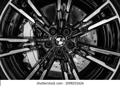 BERLIN - MAY 06, 2018: Detail of the front brake system of a mid-size luxury car BMW M5 Limousine (F90). Close-up. Black and white. Exhibition 31th Berlin-Brandenburg Oldtimer Day