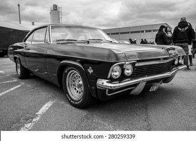 BERLIN - MAY 10, 2015: Full-size car Chevrolet Impala (fourth generation). Black and white. 28th Berlin-Brandenburg Oldtimer Day