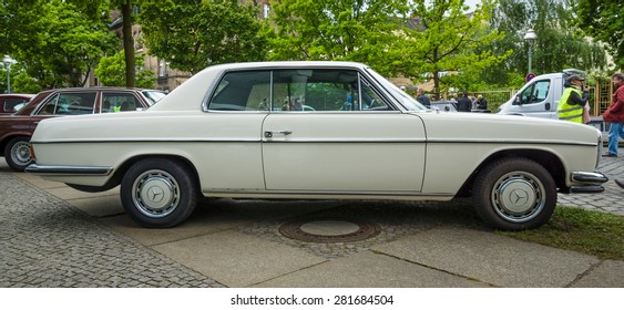 BERLIN - MAY 10, 2015: Mid-size luxury car Mercedes-Benz 250CE (W114), 1971. Side view. The 28th Berlin-Brandenburg Oldtimer Day