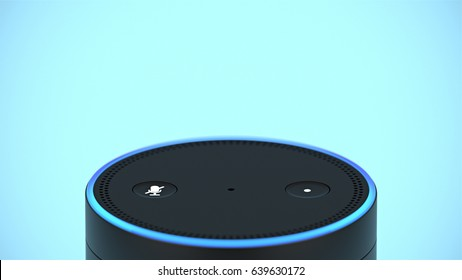 BERLIN - MAY 10, 2017: Amazon Echo top buttons close-up on blue studio backdrop with headroom for text