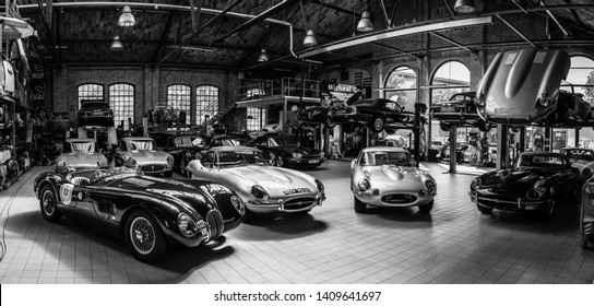 BERLIN - MAY 11, 2019: Panoramic view of the workshop for the repair and maintenance of English classic retro cars. Black and white. 32th Berlin-Brandenburg Oldtimer Day.