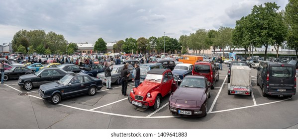 BERLIN - MAY 11, 2019: Panoramic view of the parking with various standing oldtimer and youngtimer. 32th Berlin-Brandenburg Oldtimer Day.