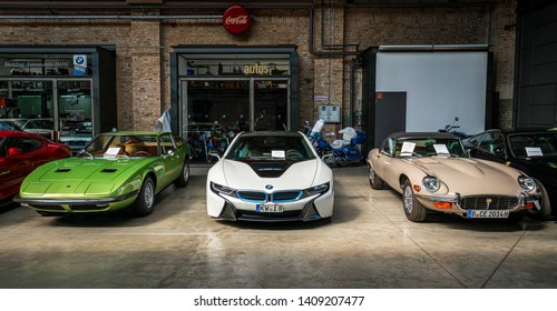 BERLIN - MAY 11, 2019: Sports cars Maserati Indy (left), BMW i8 (center), Jaguar E-type (right). 32th Berlin-Brandenburg Oldtimer Day.